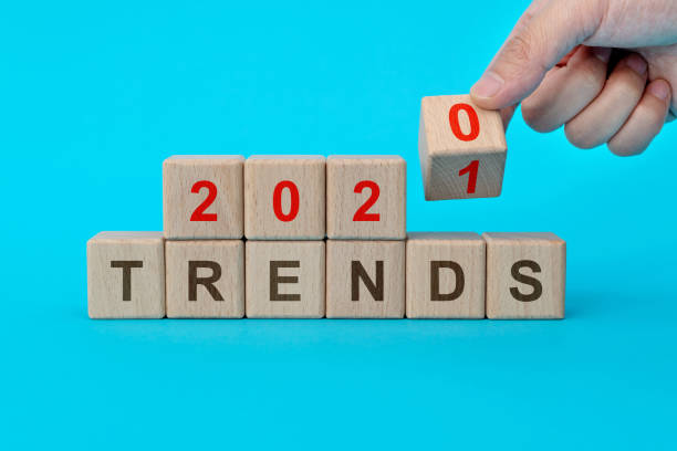 Wooden blocks with word 2021 trends stock photo