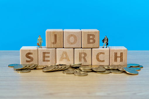 Wooden blocks with word job search.