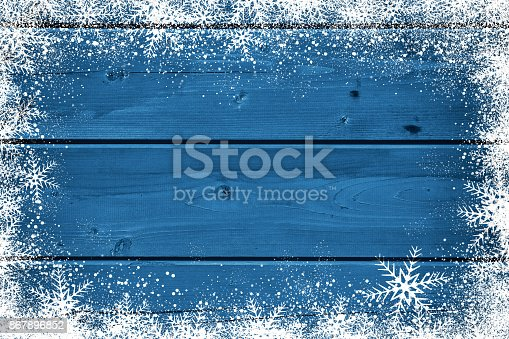 istock Wooden blue Christmas background with snowflake 867896852