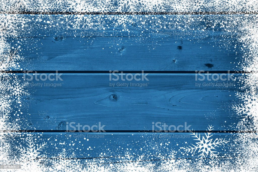 Wooden blue Christmas background with snowflake stock photo