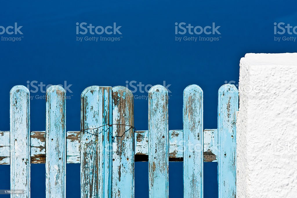 wooden blue gate against turquoise ocean royalty-free stock photo