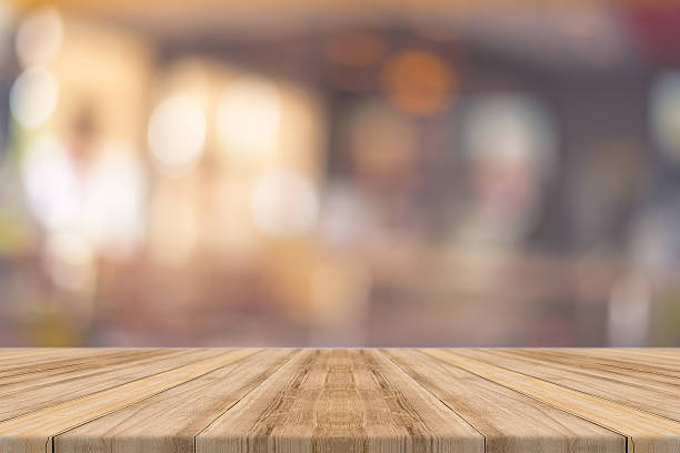 wooden board empty table blur in coffee shop. - backgrounds stock photos and pictures