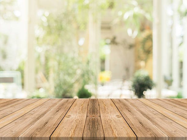 wooden board empty table blur in coffee shop. - table stock photos and pictures