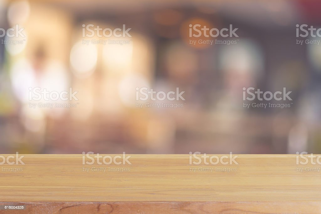 Wooden board empty table blur in coffee shop. stock photo