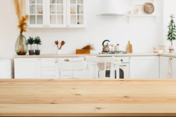 wooden board empty table in front of a blurred background. perspective brown wood with a blurred background of the kitchen and kitchen equipment - can be used to demonstrate or assemble your products. - kitchen counter imagens e fotografias de stock