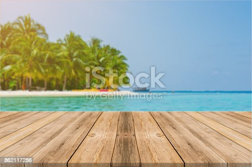 istock Wooden board empty table in front of blue sea & sky background. Perspective wood floor over sea and sky - can be used for display or montage your products. beach & summer concepts. 862117286