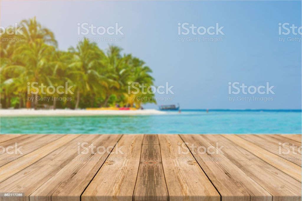 Wooden board empty table in front of blue sea & sky background. Perspective wood floor over sea and sky - can be used for display or montage your products. beach & summer concepts. stock photo