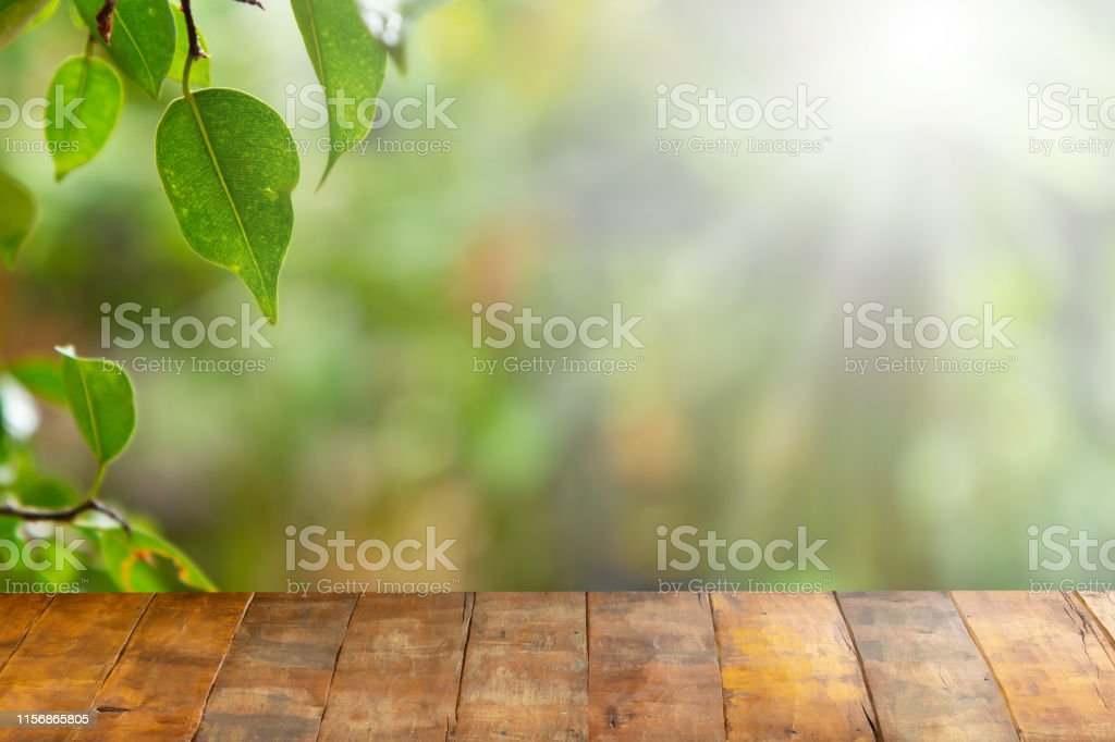 Wooden board empty table in front of blurred natural background....