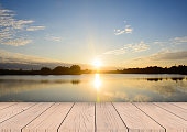 istock wooden board empty table sea and sky sunset background 537456086