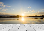 istock wooden board empty table sea and sky sunset background 537456234