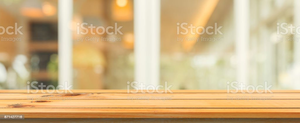 Wooden board empty table top blurred background. Perspective brown...