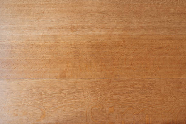 Wooden board of a rustic table view in close up from top stock photo