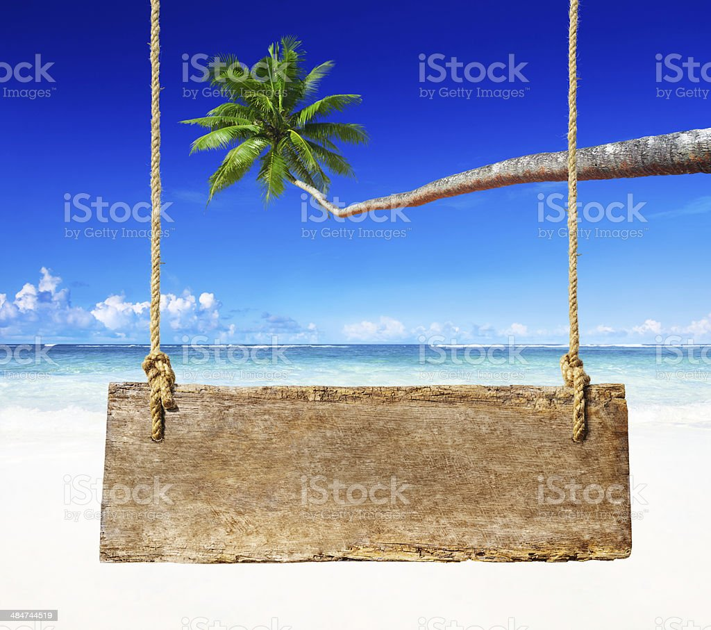 Wooden board on the beach stock photo