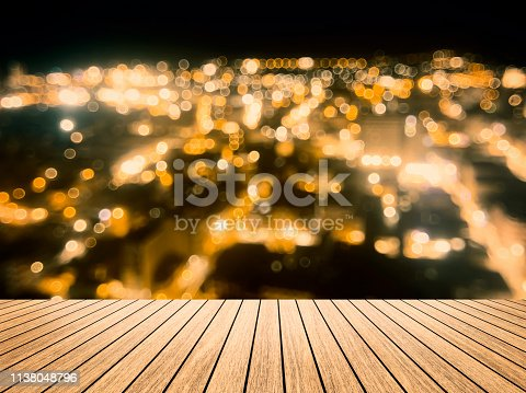istock Wooden board table  in front of blurred pattani public mosque background. concept for islam, allah, ramadan, pray, muslim, hope, faith, war, holy. 1138048796