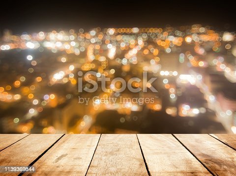 istock Wooden board table  in front of blurred pattani public mosque background. concept for islam, allah, ramadan, pray, muslim, hope, faith, war, holy. 1139369844