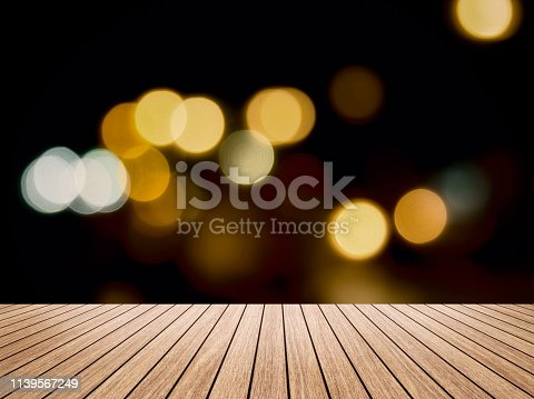 istock Wooden board table  in front of blurred pattani public mosque background. concept for islam, allah, ramadan, pray, muslim, hope, faith, war, holy. 1139567249