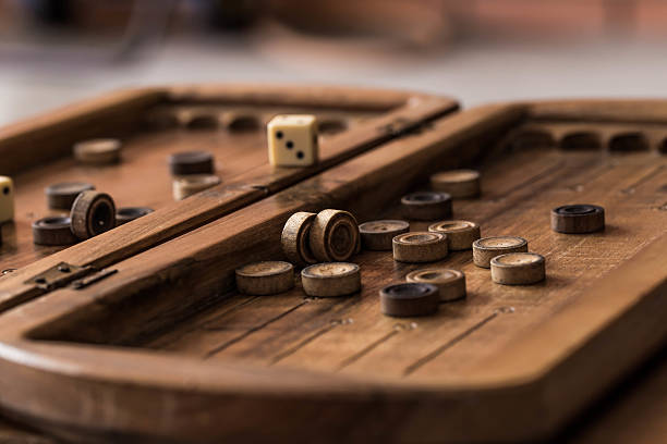 wooden board with backgammon, pawns, dice, close up - backgammon stock pictures, royalty-free photos & images