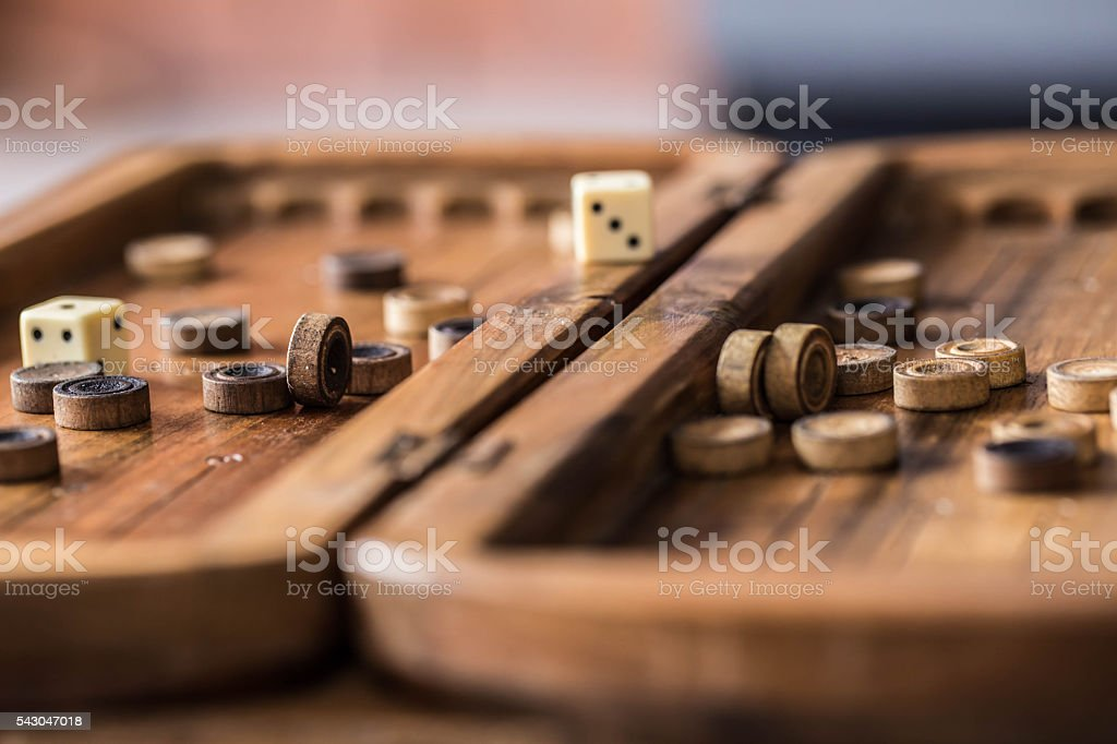 wooden Board with backgammon, pawns, dice, close up - Photo