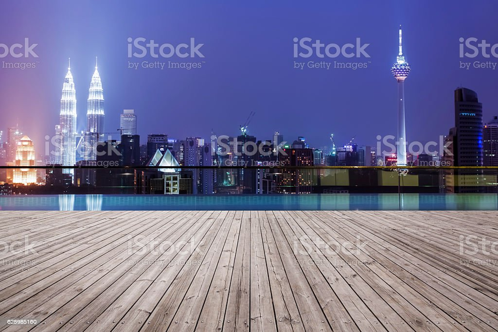 Wooden board with city night stock photo