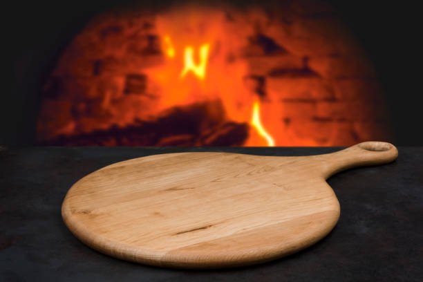 Wooden board with handle for pizza or other bakery display stock photo