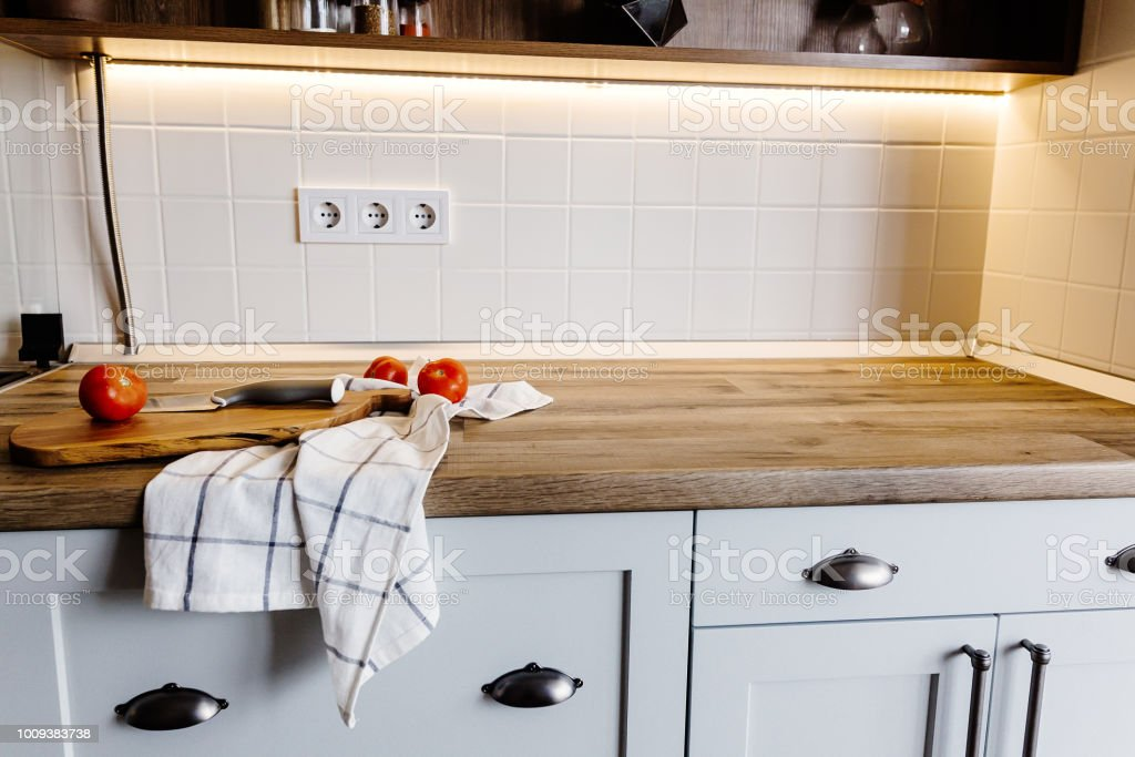 Wooden Board With Knife Tomatoes Towel On Modern Kitchen ...