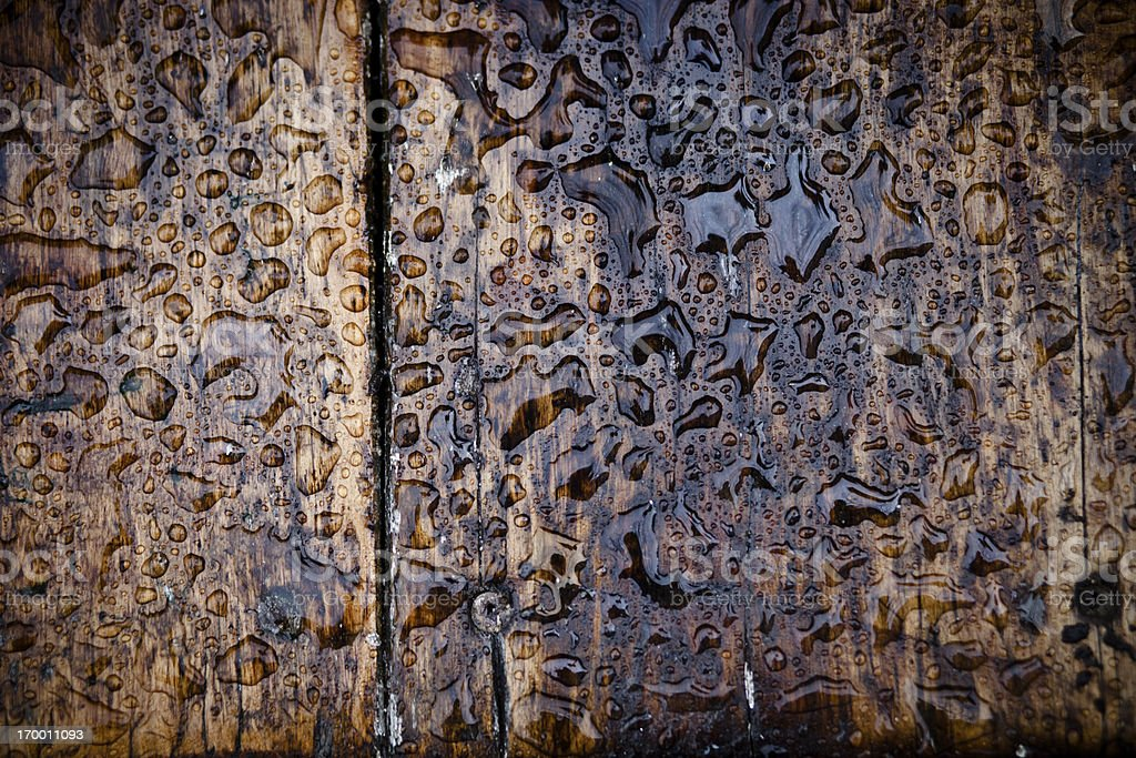 Wooden board with raindrops royalty-free stock photo