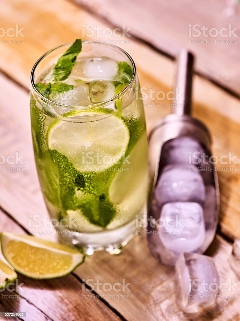 Wooden boards glass with mohito and scoop ice. Top view. stock photo