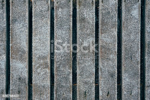 Wooden boardwalk covered with hoarfrost, top view
