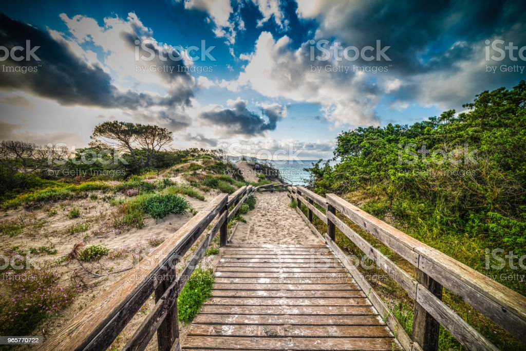 Wooden boardwalk in Alghero coastline at sunset - Royalty-free Alghero Stock Photo