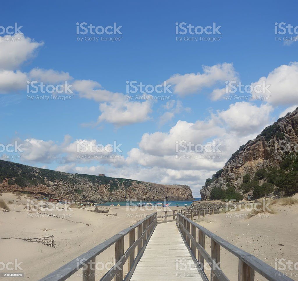 wooden boardwalk in Cala Domestica stock photo