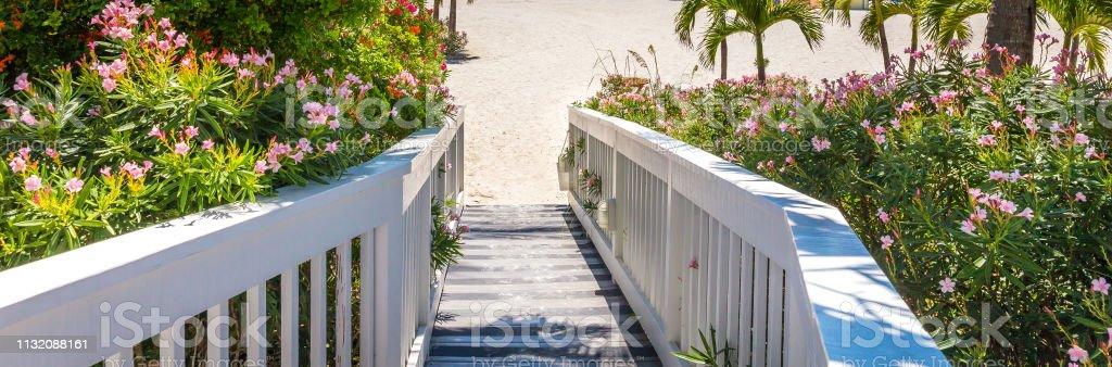 Wooden Boardwalk on beach in St. Pete, Florida, USA stock photo