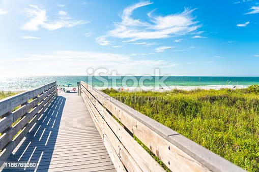 Wooden path to Indian rocks beach in Florida, USA