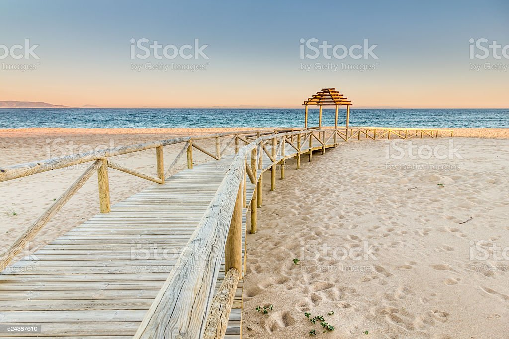 Wooden boardwalk to the beach. Idyllic scene stock photo