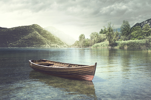 Wooden boat floating in a mystic river