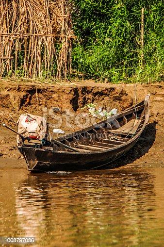 Wooden boat halts at riverside at Hpa-An