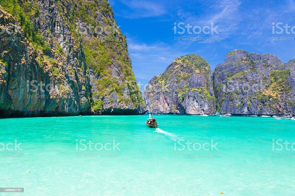 Wooden boat in Maya bay, Thailand. stock photo