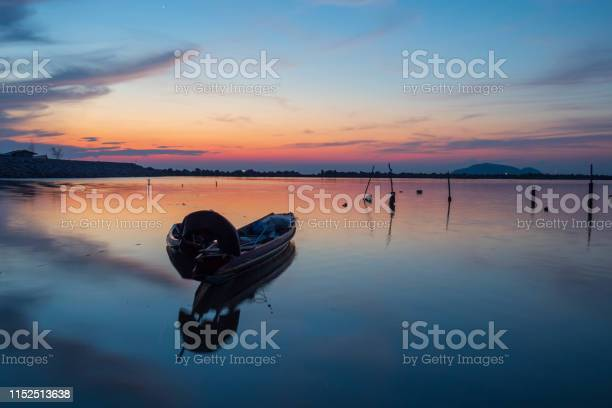 Photo of Wooden boat in thailand at sunrise