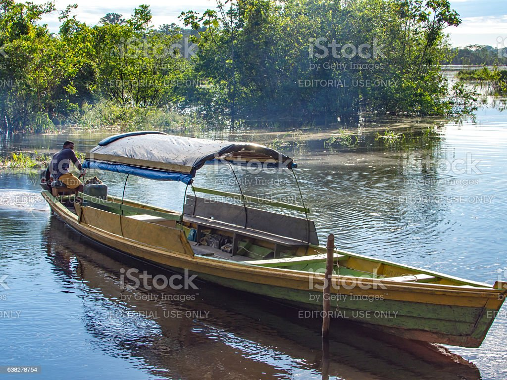 Wooden  boat  on the river stock photo