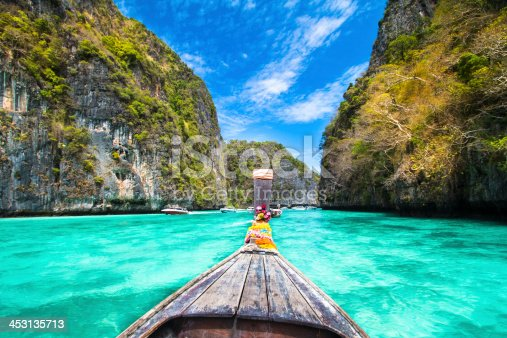 istock A wooden boat sailing near phi island in Thailand 453135713