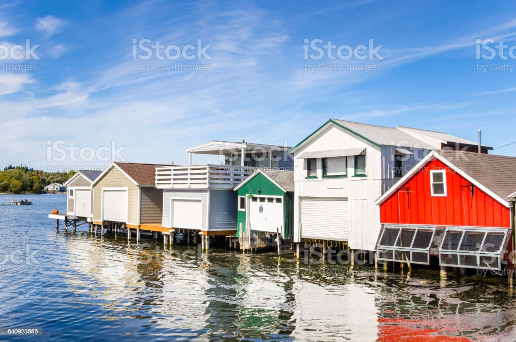 Wooden Boathouses on a Clear Autumn Day stock photo