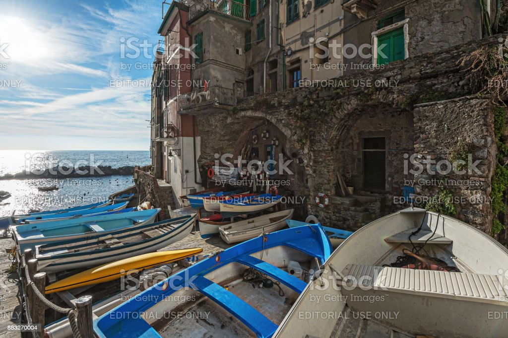 Wooden boats are moored at coast of Riomaggiore town in Cinque Terre National park, Italy stock photo