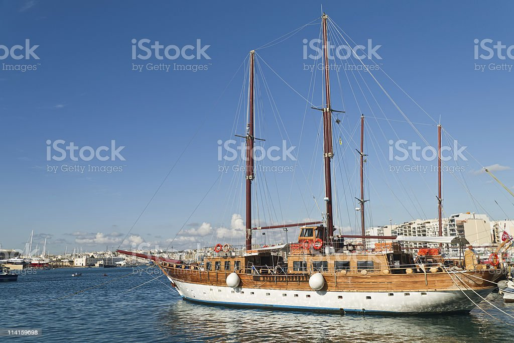 Wooden boats are waiting for blue yathcing in Malta royalty-free stock photo