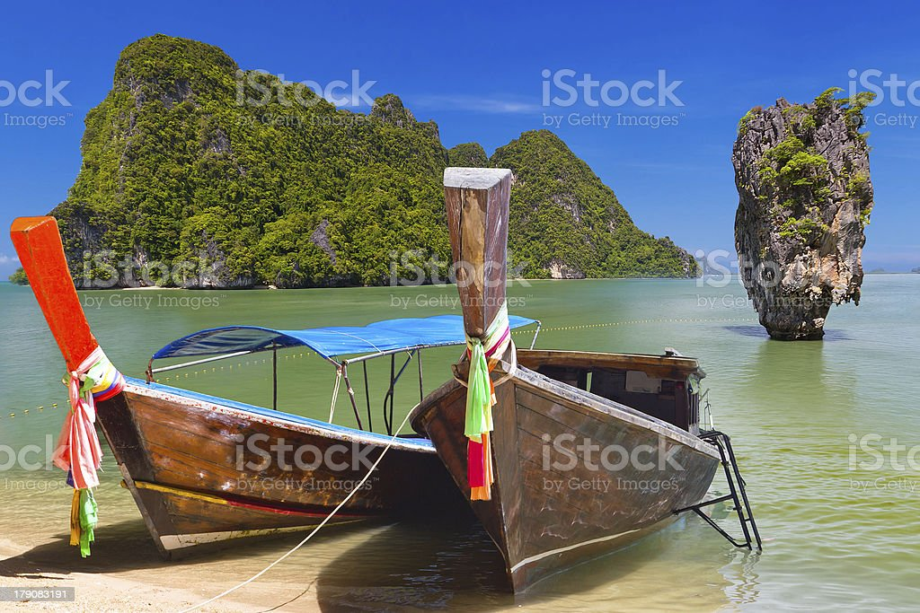 Wooden boats at shore in Thailand with blue sky on sunny day stock photo