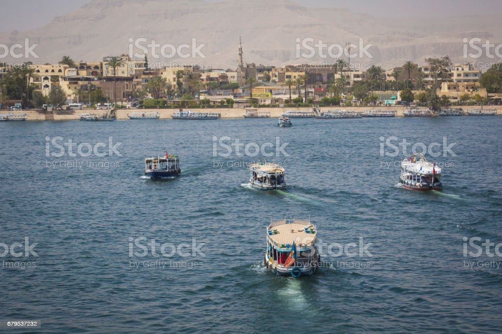 Wooden boats carrying passengers docked along the Nile River in Aswan, Egypt, North Africa stock photo
