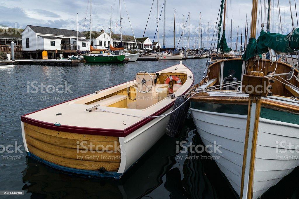 Wooden boats in marina stock photo