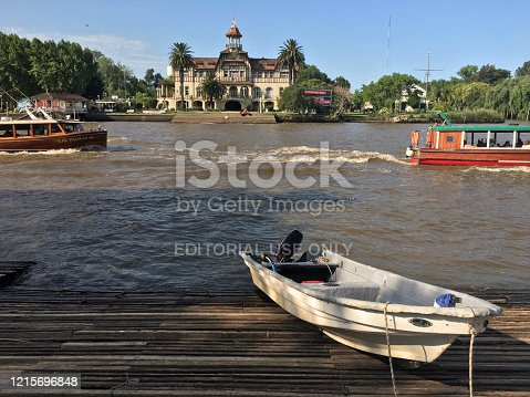 Tigre, Buenos Aires province, Argentina - January 8, 2020: Wooden boats with tourists sailing on the Lujan river. Tigre lies on the Paraná Delta and is a very popular tourist and weekend destination