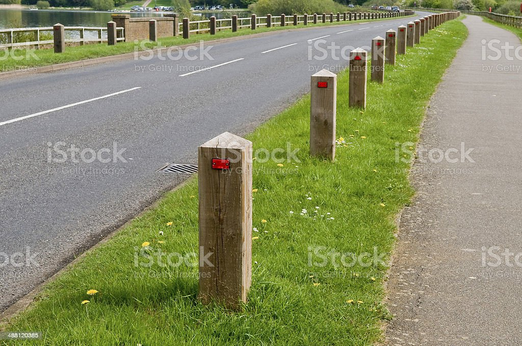Wooden Bollards and grass verge royalty-free stock photo