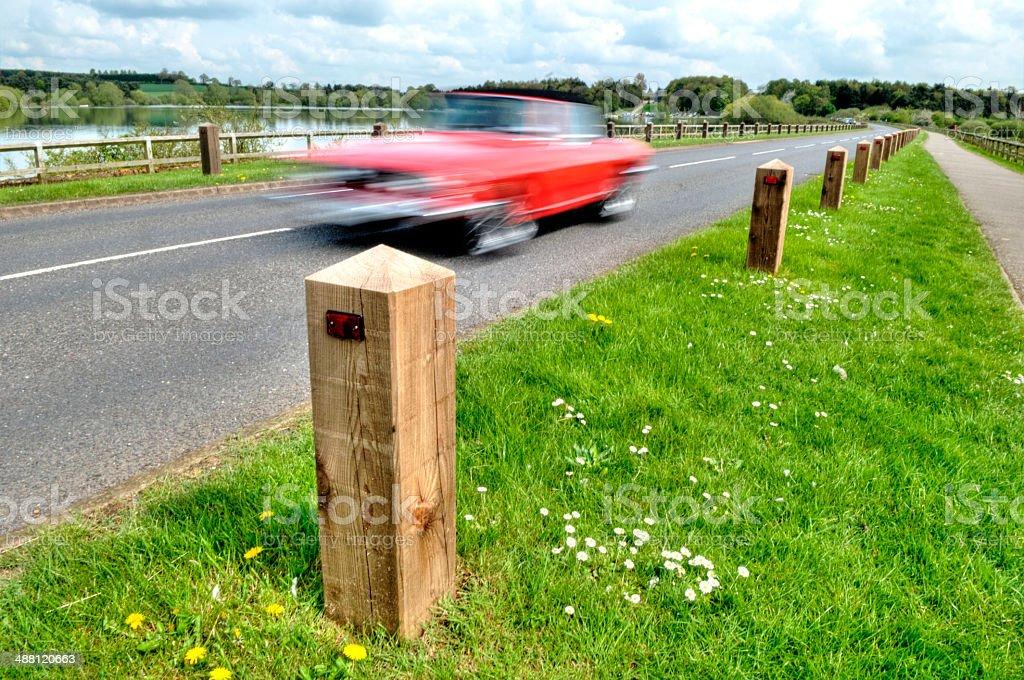 Wooden bollards and speeding car royalty-free stock photo