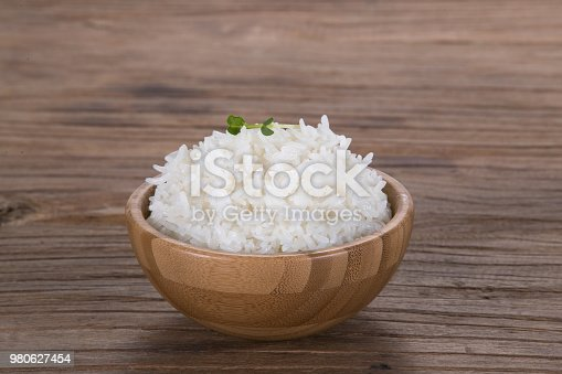 A wooden  bowl of rice