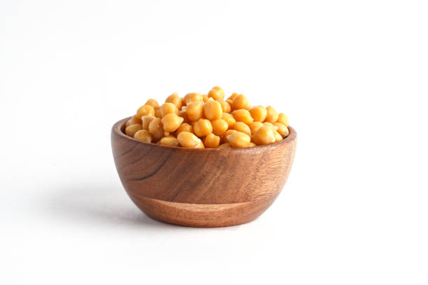 Wooden bowl of preserved (boiled) chickpea isolated on white background Wooden bowl of preserved (boiled) chickpeas isolated on white background chick pea stock pictures, royalty-free photos & images